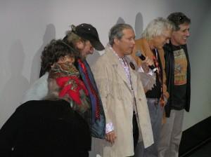 Michael Wadleigh (bandana), Michael Lang (blocked), Fred Weintraub, Jeffrey Baker, Artie Kornfeld, Joel Rosenman