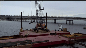 Moving railroad ties onto barge_3.17.21