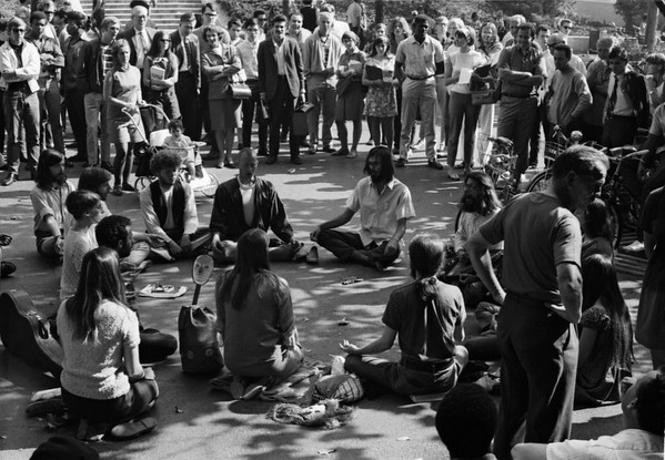 5*Fri, Oct 25, 1968*People: yoga groupSubject: *Place: sproul plaza, campusActivity: Comments: Holy Hubert in R foreground.  Spectators really looked intently.