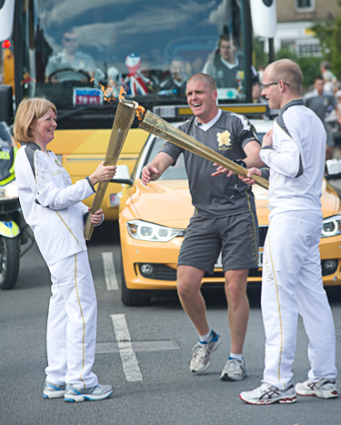 The Olympic kiss between Harry Heathfield and Nicky WardaleOlympic Torch relay in Cromer, North Norfolk