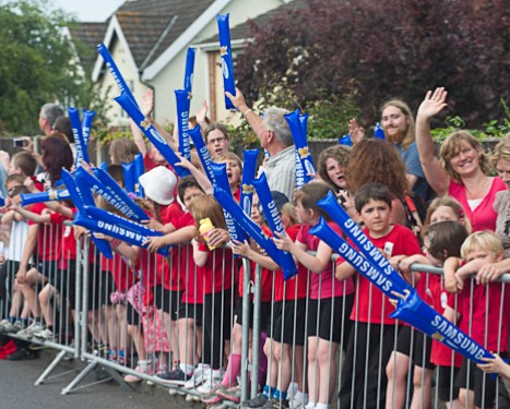 School childen waiting for the arrival of the Olympic Torch relay in Cromer, North Norfolk
