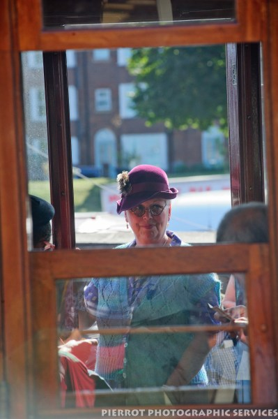 Woman looking through railway carriage window at the 1940s weekend in Sheringham, North Norfolk 2012