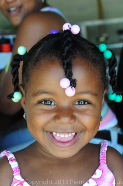 Cute Haitian girl in braids, Sanama, Dominican Republic