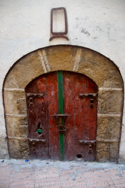 Moroccan arched door leading into a riad in the medina in Essaouira, Morocco