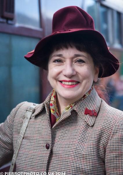 1940s weekend in Sheringham North Norfolk 2014 - woman in red felt hat