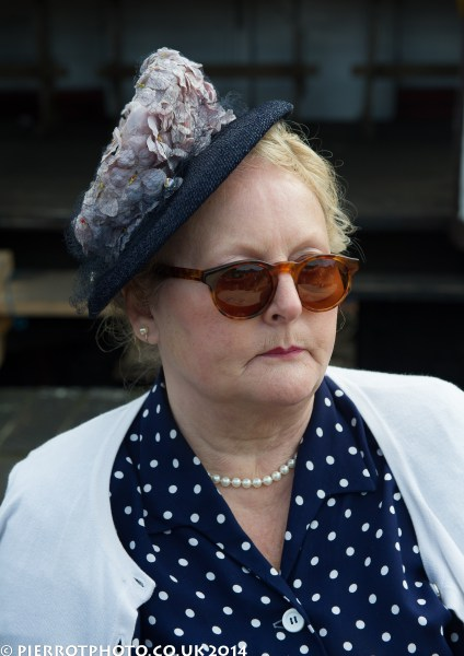 1940s weekend in Sheringham North Norfolk 2014 - woman in polka dot dress and blue hat