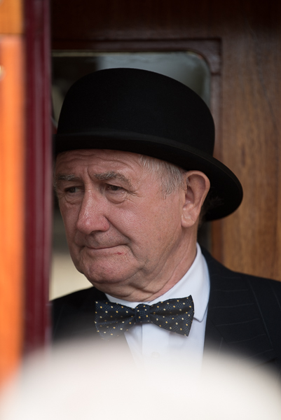 1940s weekend in Sheringham North Norfolk 2017. Man in black hat and bow tie in railway carriage