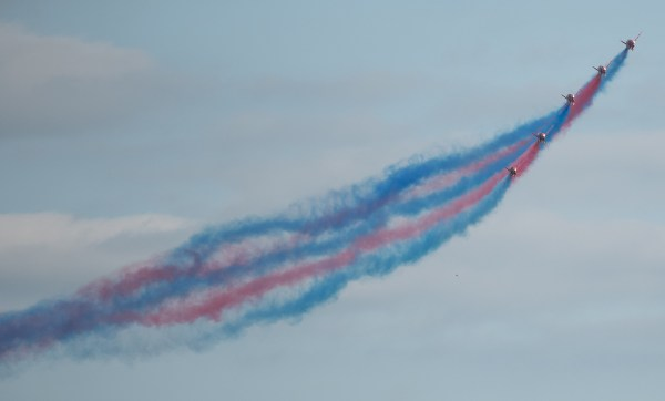 Red Arrows flying with vapour trails at Cromer carnival