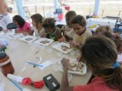 Girls look for invertebrates.