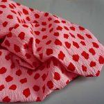 Seersucker red dot on pink -