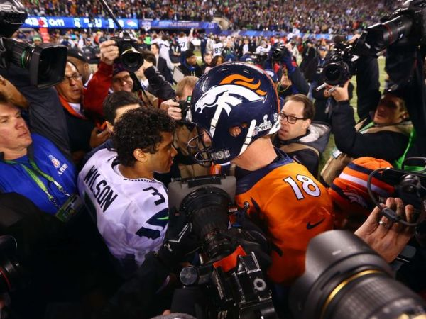 Peyton Manning congratulates Russell Wilson on his Super Bowl victory. (Photo: Rebilas/USA TODAY Sports)