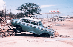 The aftermath of Hurricane Camille. Ruins of Texaco gas station with Rambler automobile,  Biloxi, Mississippi, 17 August 1969