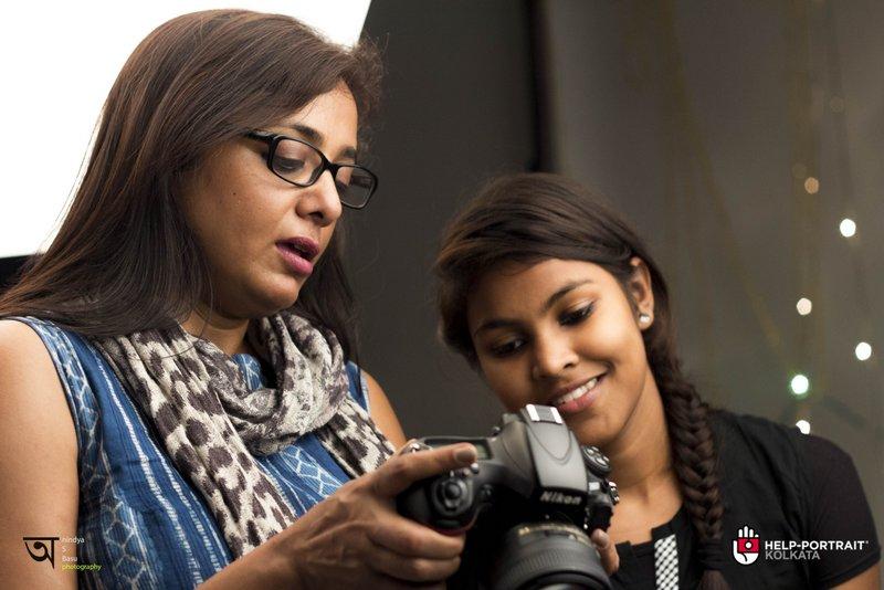 Help Portrait kolkata 2014 where Anjali analyzes the picture with Jayati Saha