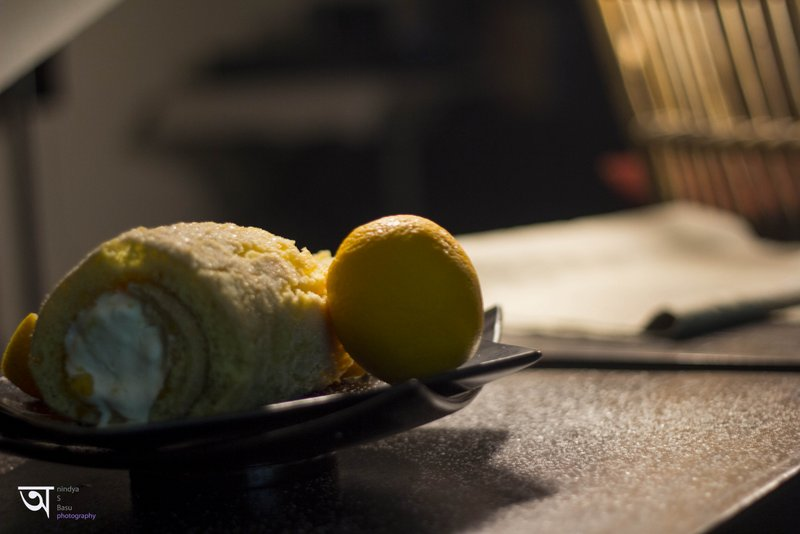 Orange Swiss roll in diffused lighting