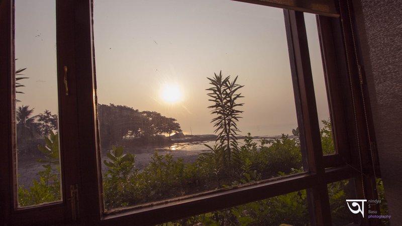 Resort room window view of Sunrise from Ganga Kutir