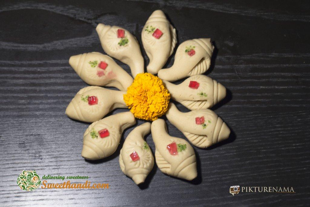 Sankh sondesh spread out as beginning of auspicious journey of sweethandi kolkata with pikturenama