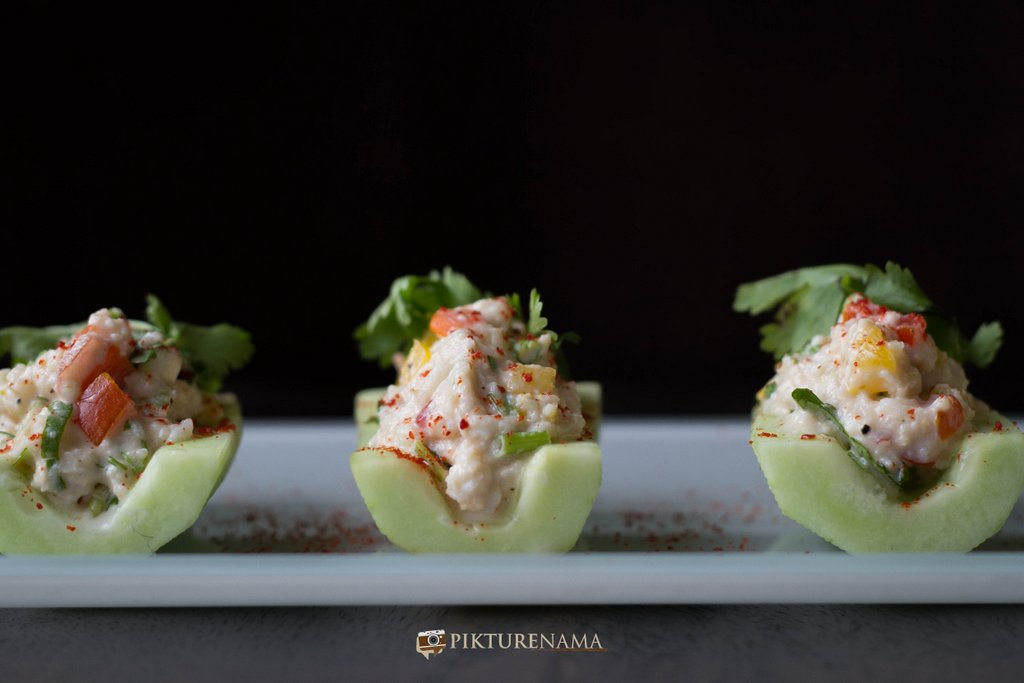 Cold crab salad in cucumber boats is ready to eat by pikturenama