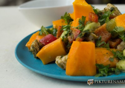 Close up of Mango Chicken salad with zesty coriander and chili dressing