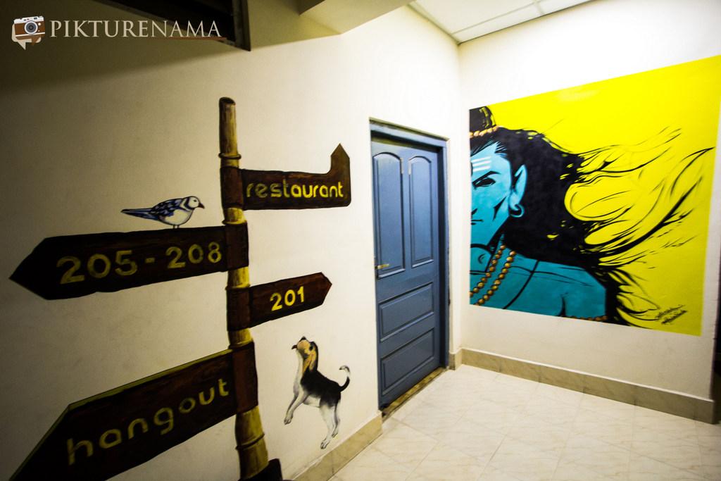 Varanasi Zostel by pikturenama graffiti on the wall