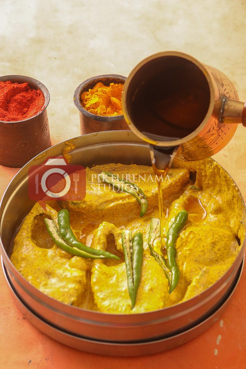 Addition of mustard oil to Bhapa Ilish