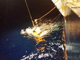 Deploying the ocean bottom seismometer (OBS) into the ocean.