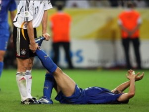 footballer with muscle cramp