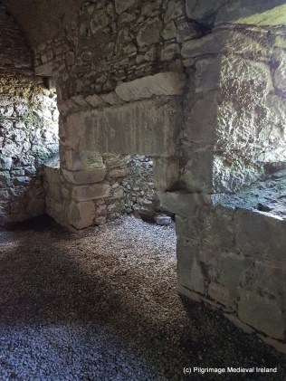 Large finely carved fireplace in the east wall of east range at Askeaton Friary..
