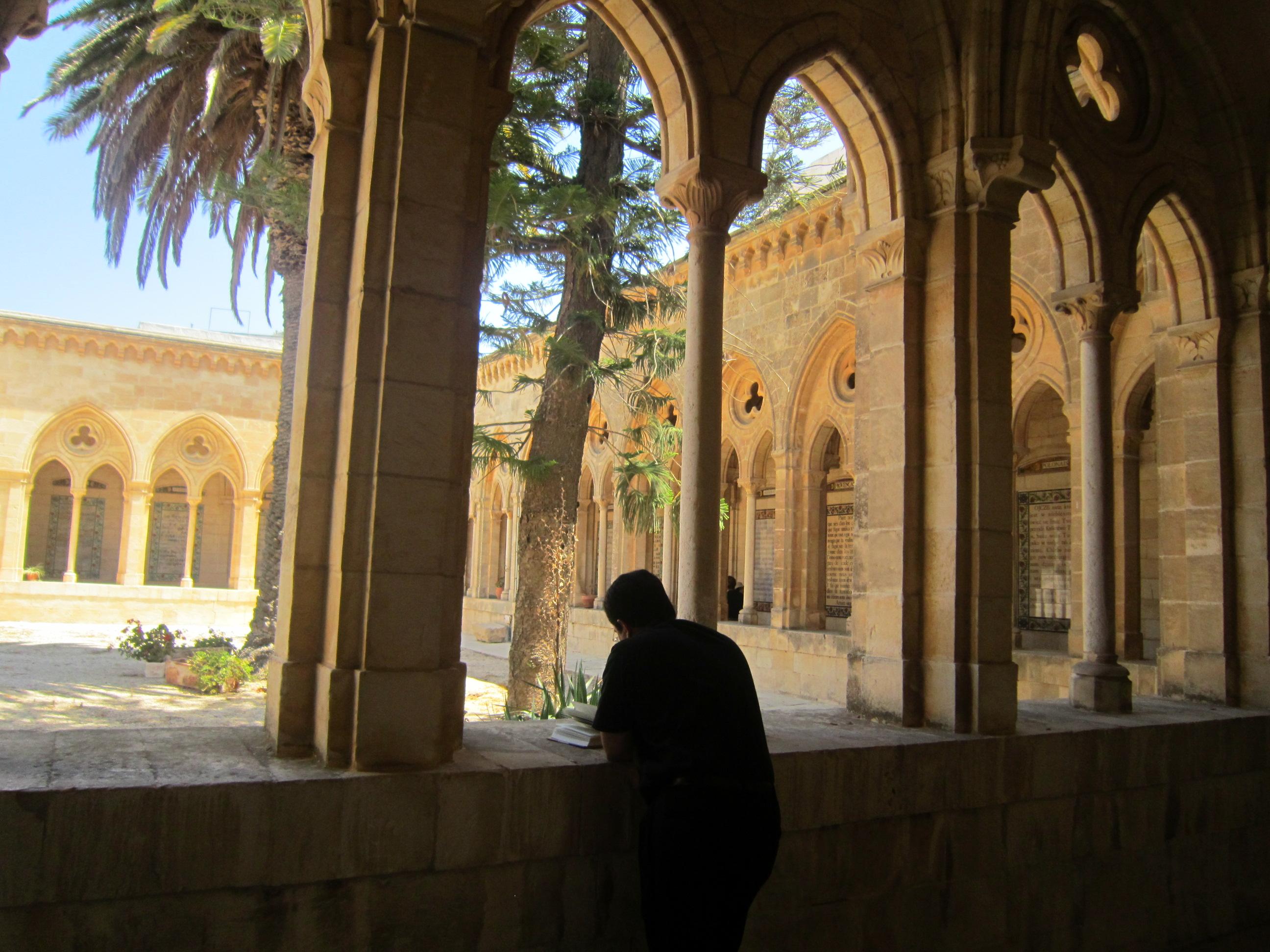 Bishop Oscar Cantu meditates at Pater Noster in Jerusalem while on pilgrimage with us.