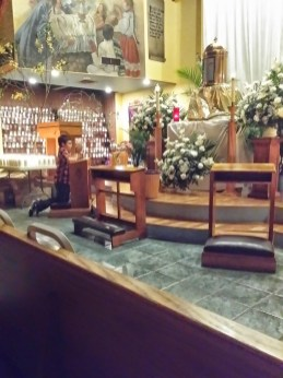 Jason's son praying in front of the Blessed Sacrament