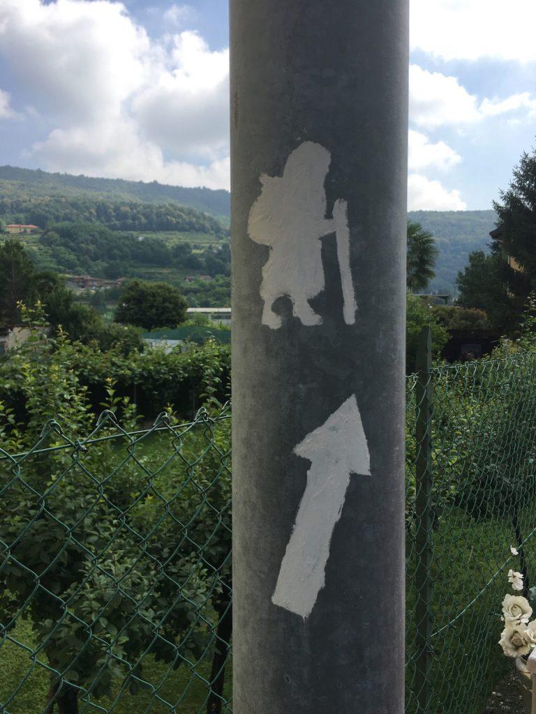 White pilgrim sign just outside of Ivrea