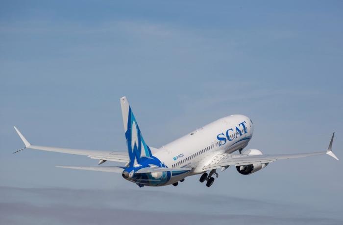 Самолет компании СКАТ в воздухе
