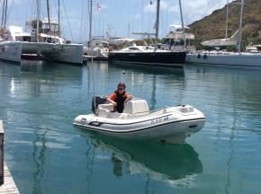 Ryan docking the dingy, Nanny Cay