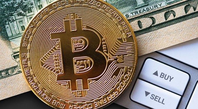 Bitcoin alcanza un nuevo récord, supera los 58,000 dólares