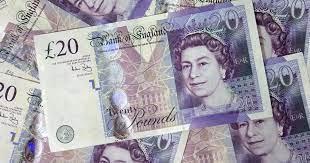 Libra esterlina cae a mínimo de un mes frente al dólar