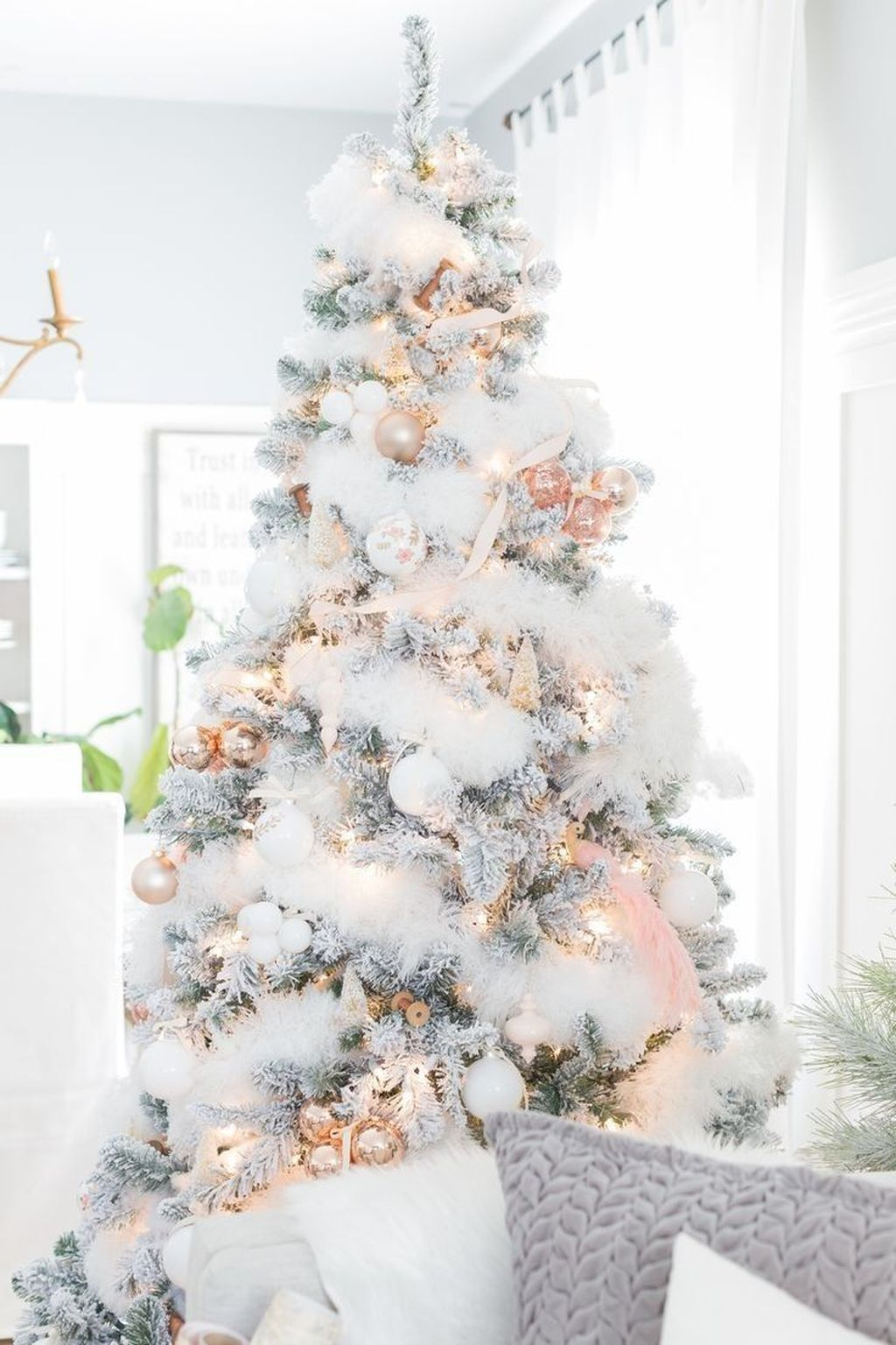 Stunning White Christmas Tree Ideas To Decorate Your Interior 22