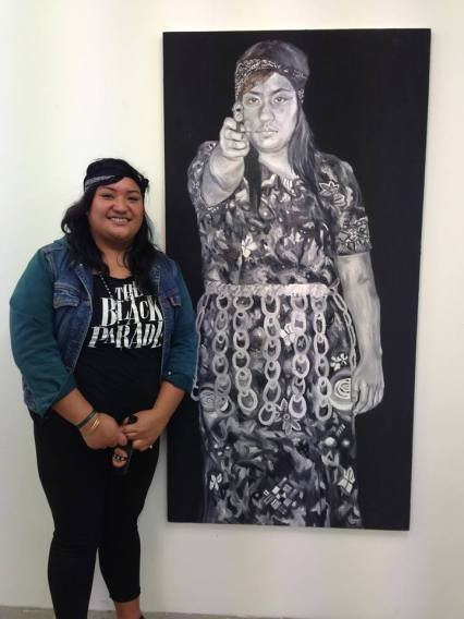 """Ana Lakusa with work from her """"From Heaven to Hell"""" series"""