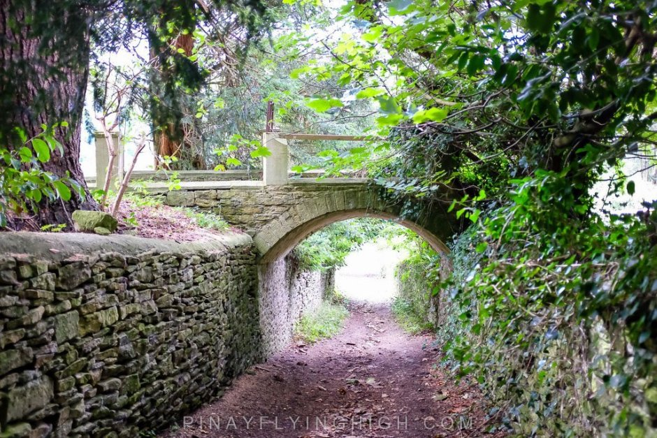 The path to Castle Combe from Fosse Farmhouse passes through an ancient bridge.