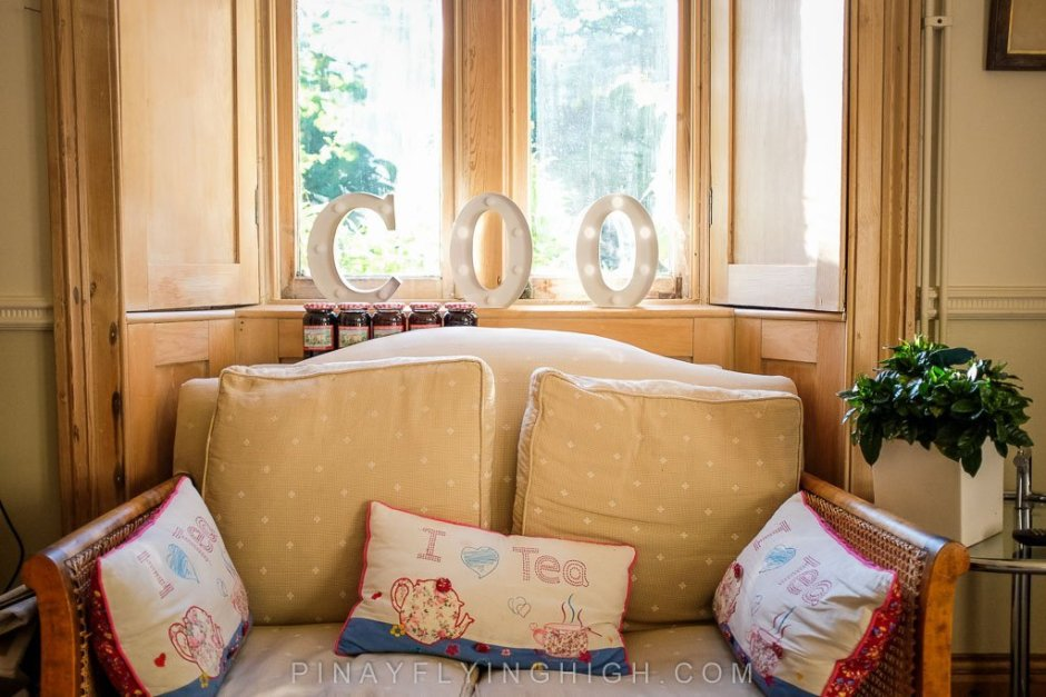 The cozy and charming receiving area of a bed and breakfast, Fosse Farmhouse in CAstle Combe.