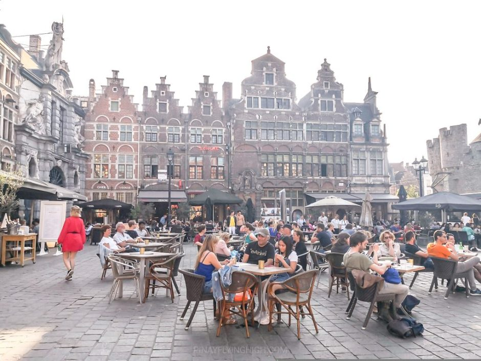 A square surrounded by medieval architecture in Ghent, Belgium