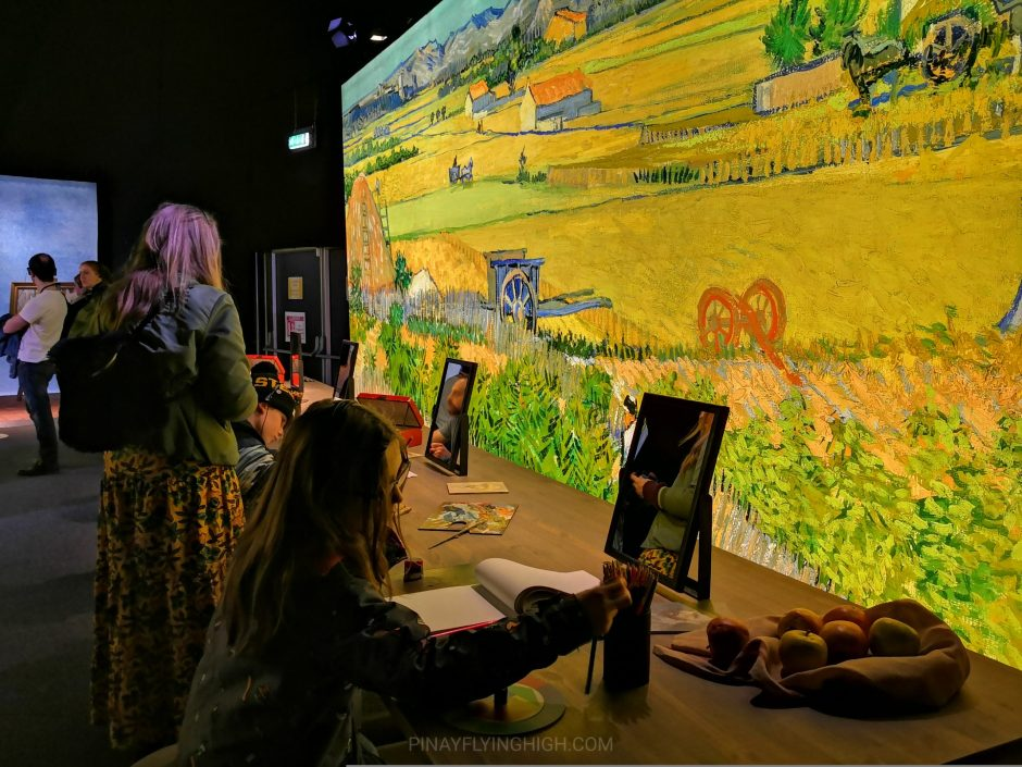 kids trying to draw a self-portrait at meet vincent van gogh experience