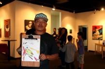 Ivan Garcia, 22, poses with his picture celebrating Phoenix art.