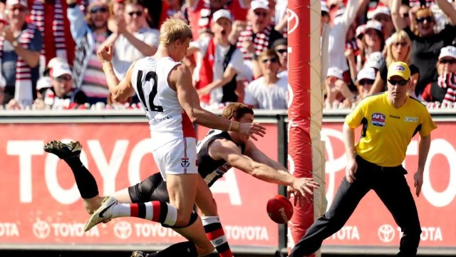Heath Shaw sneaks up on Nick Riewoldt like a librarian one of the Pinch Hitters Top Six Magpies Moments of the 2010's.