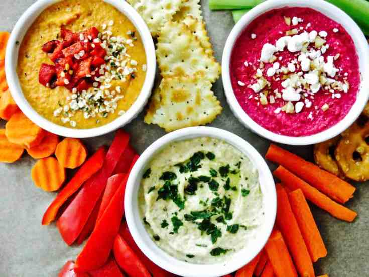 3 amazing versions of hummus that can be pulled together for any quick snack or party! My classic hummus, roasted red pepper hummus and an amazing beet hummus. So quick and easy. Great for entertaining!  #homemadehummus, #redpepperhummus, #beethummus