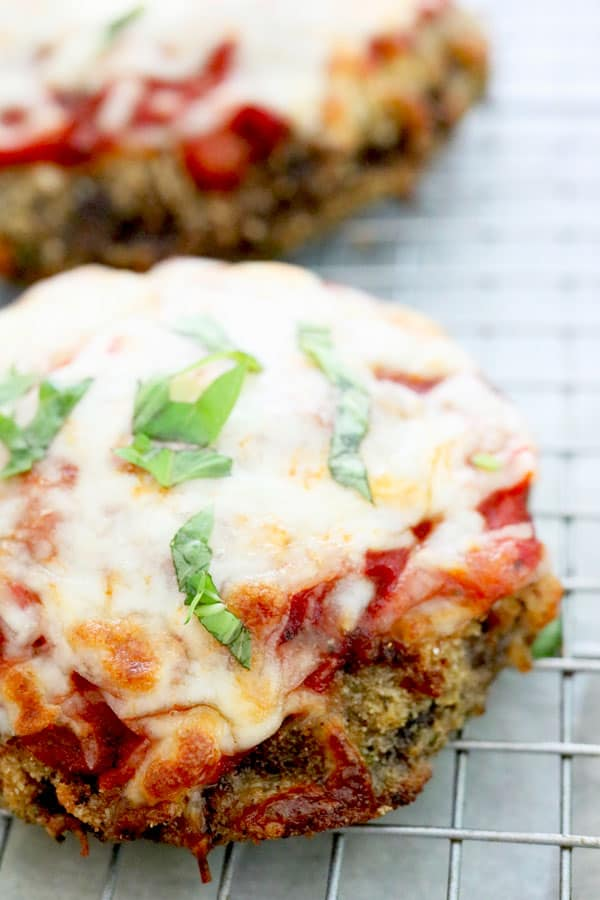 Incredible vegetarian Portobello Mushroom Parmesan!  Easy steps, low-calorie, meat-free and oh so good!  Kid-Friendly and great recipe for entertaining.  Crispy portobello mushrooms, covered in red sauce and melted cheese.  Yum!!!