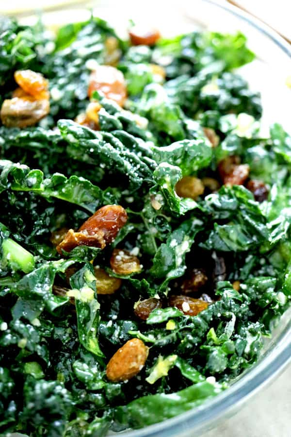Super easy kale salad with pistachios and lemon side angle view