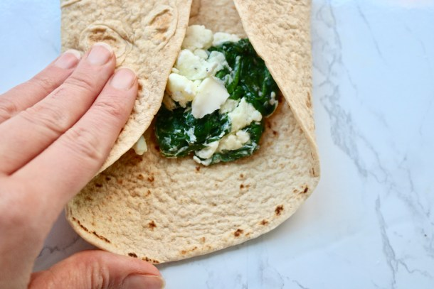 Wrapping up a spinach and feta egg wrap