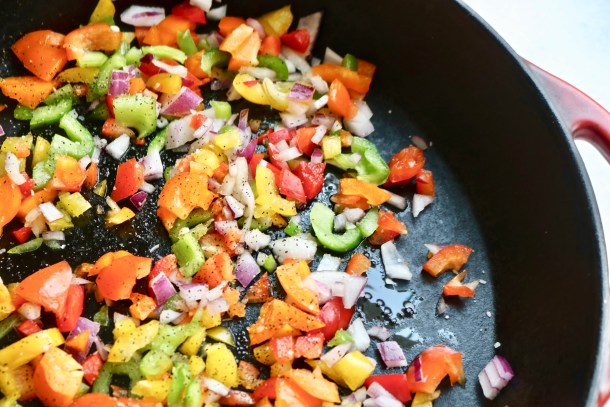 Onions and peppers sautéed in pan