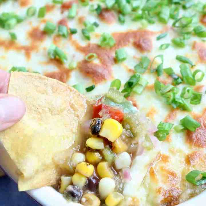 Dipping chip into layered bean dip