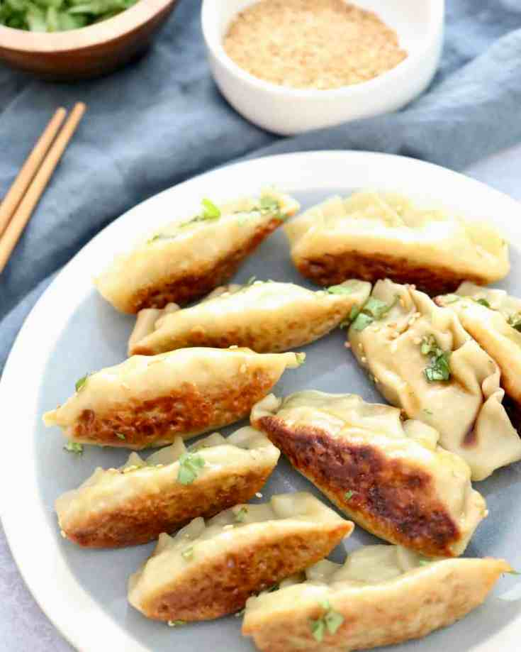 Super Easy Edamame Potstickers - Hearty edamame, zingy garlic, soy sauce and sesame oil make up the incredible filling in this healthy vegetarian recipe that you MUST TRY!