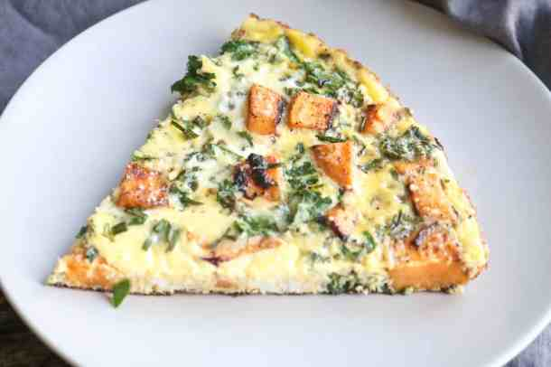 Slice of kale and sweet potato frittata